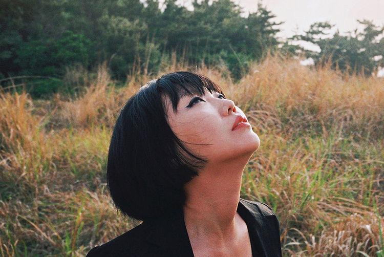 Portrait of woman in field