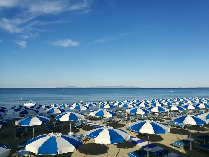 High Angle View Of Parasol At Beach Against Sky