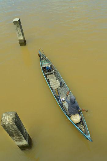 High Angle View Of Man Sitting In Rowboat At Lake