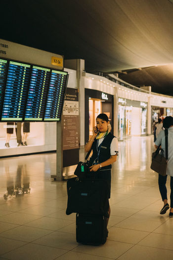 Bangkok Thailand VSCO Adult Airport Airport Departure Area Airport Terminal Arrival Departure Board Communication Flooring Full Length Illuminated Incidental People Indoors  Journey Lifestyles Luggage Mode Of Transportation One Person Real People Tiled Floor Transportation Travel Vscocam Women