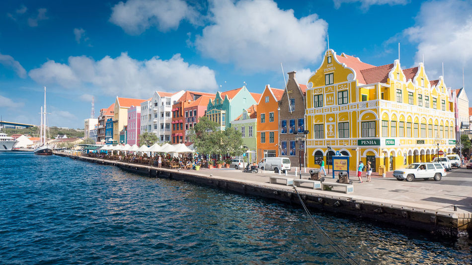 Architecture Blue Building Exterior Built Structure Carribean City Cityscape Cloud - Sky Curacao Day History Multi Colored Outdoors Paradise People Residential Building Sky Summer Travel Travel Destinations Vacations Water Willemstad Willemstad Harbour