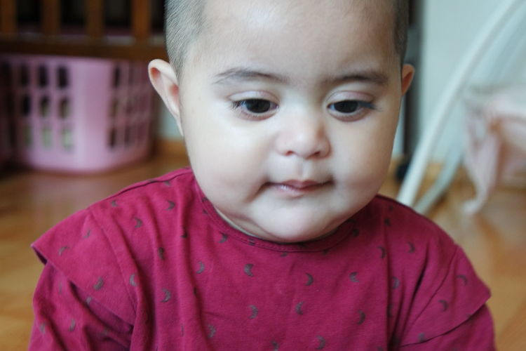 Portrait of cute baby at home