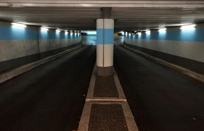 Interior of empty illuminated parking lot