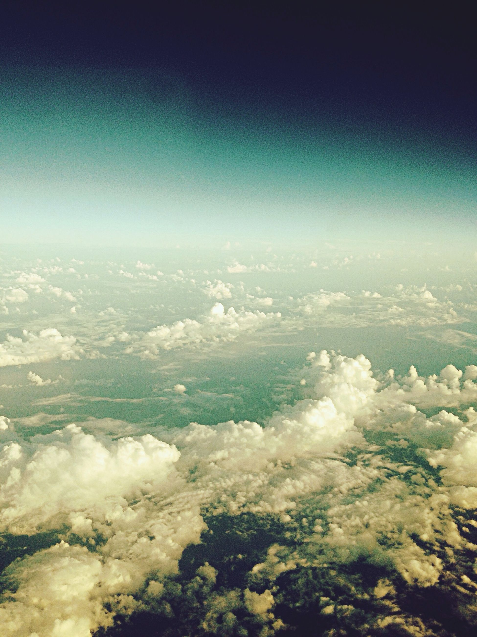 aerial view, scenics, beauty in nature, nature, sea, blue, tranquil scene, sky, tranquility, water, landscape, idyllic, day, no people, outdoors, white color, copy space, majestic, clear sky, airplane