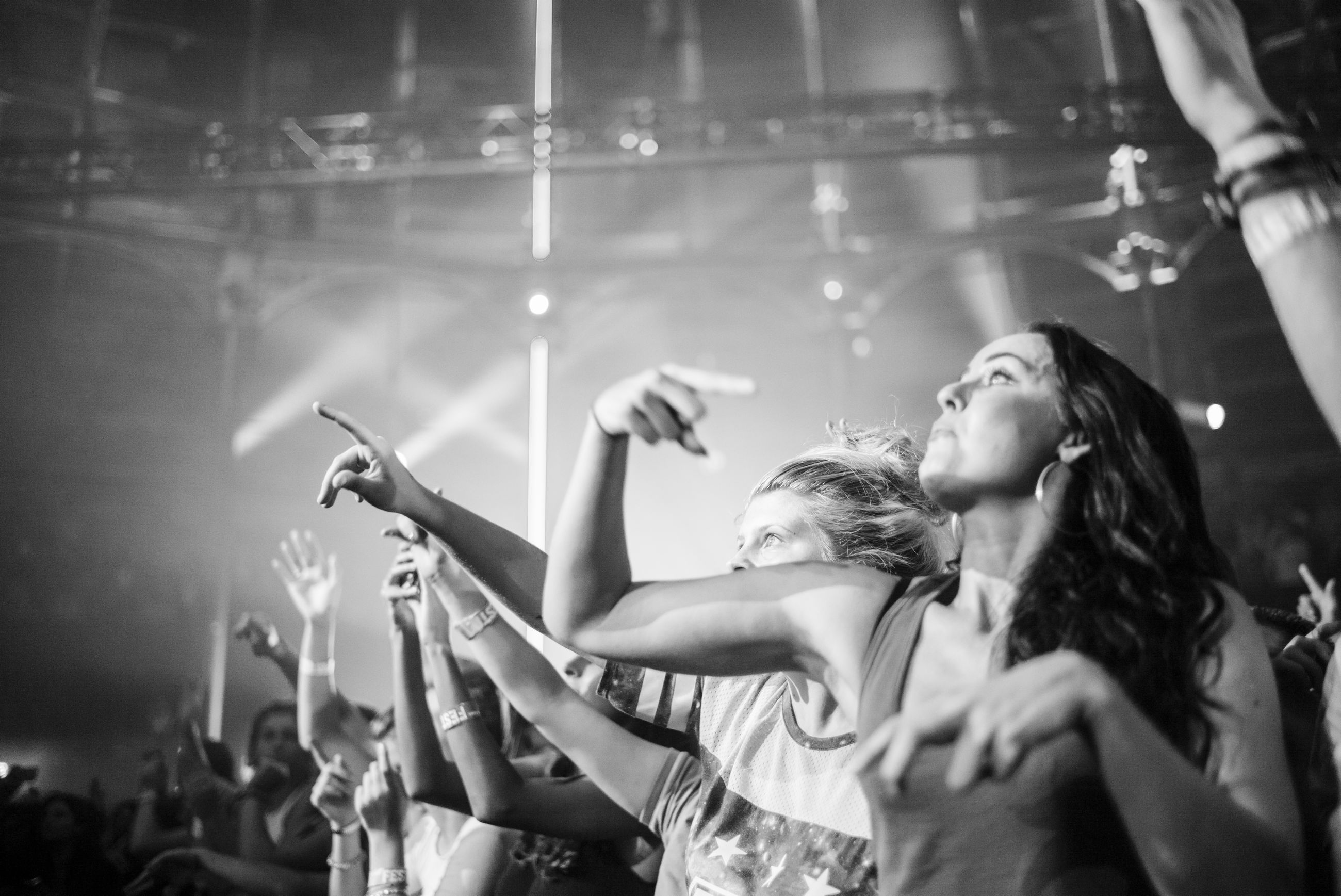 lifestyles, indoors, leisure activity, young adult, togetherness, enjoyment, fun, young women, performance, illuminated, holding, person, casual clothing, arts culture and entertainment, standing, music, nightlife, men