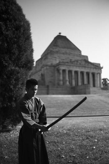 The modern samurai. Adult Architecture Building Exterior Built Structure Clear Sky Day History Leisure Activity Lifestyles Nature One Person Outdoors People Real People Sky Standing Tree Young Adult Young Men