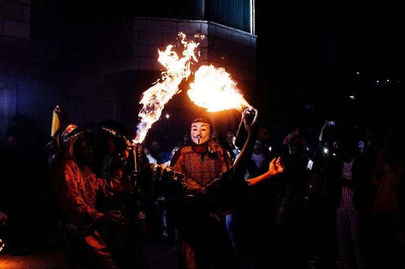 People at bonfire at night