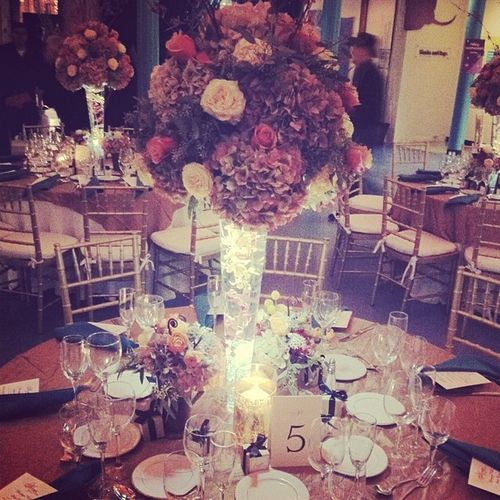 The stunning centerpieces for the Wedding . Theflorallife Florist Flowers