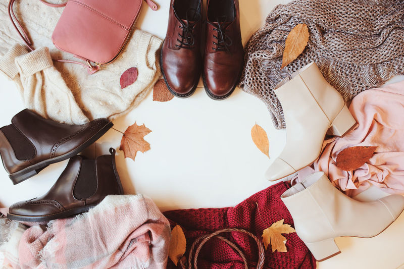 High angle view of shoes and sweaters on floor
