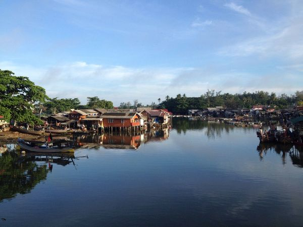 Village of Fisherman in Narathiwat, Thailand Architecture Water Building Exterior Built Structure Sky Reflection Outdoors Day Cloud - Sky Nature Tree No People Village Sea Fisherman Fishing Boat Fisheries Floating House Thailand