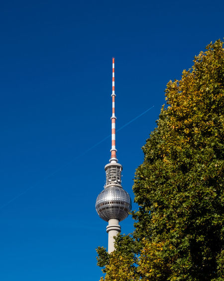 Autumncity Architecture Built Structure Building Exterior Plant Tree Outdoors No People Nature Day Ralfpollack_fotografie Fujix_berlin Blue Sky Tall - High Tower Low Angle View Tourism Clear Sky Travel Destinations Travel Global Communications Silver Colored Fernsehturm Berlin  Berlin Photography Autumn Mood
