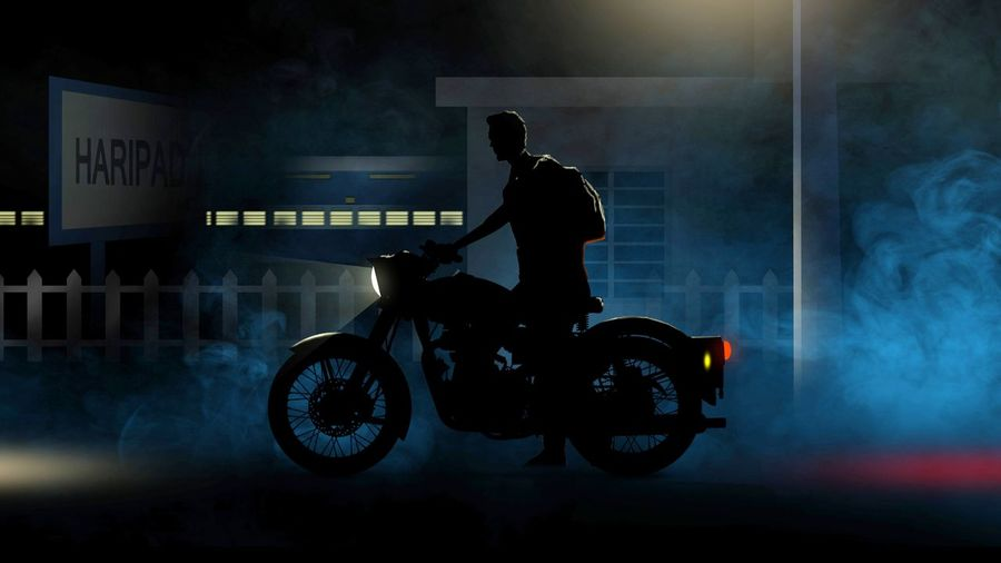Side view of silhouette man riding motorcycle at night