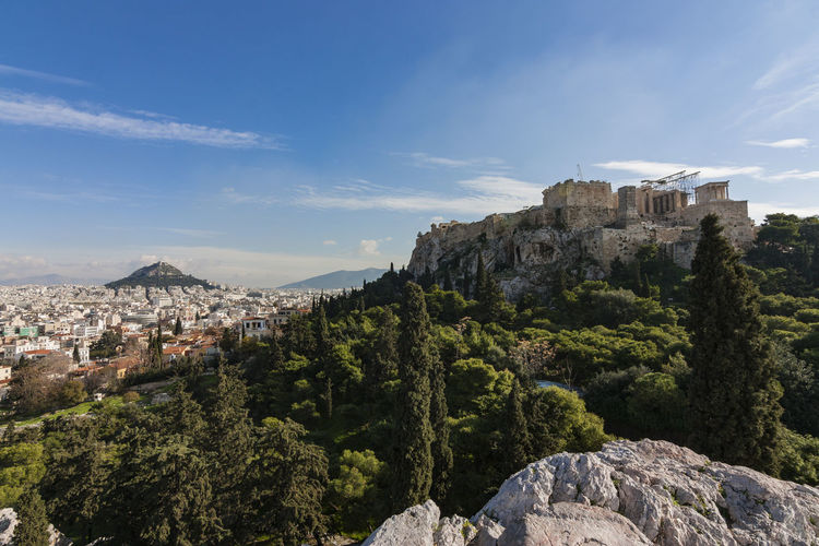 Acropolis of Athens from Temple of Hephaestus, Athens, Greece Above Acropolis Acropolis Of Athens Ancient Architecture Athens Beauty In Nature Blue Cityscape Day Destination Greece Greek Mountain Nature No People Outdoors Park Ruins Sky Temple Temple Of Hephaestus The Acropolis Tourist Attraction  Trees