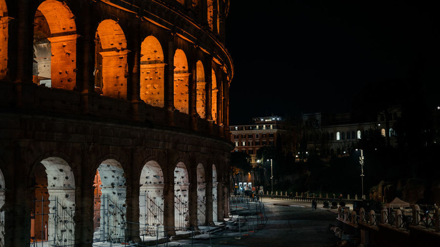 Illuminated buildings in city at night colosseo colosseum