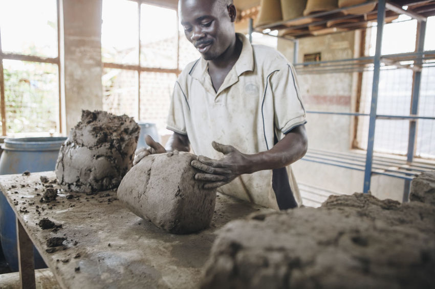 Adults Only Africa African Business Ceramic Clay Factory Filter Hand Work Indoors  Manual Worker Manufacturing Men People Pots Pottery Raw Raw Material Sculpting Social Business Table Tools Water Filter Working Workshop