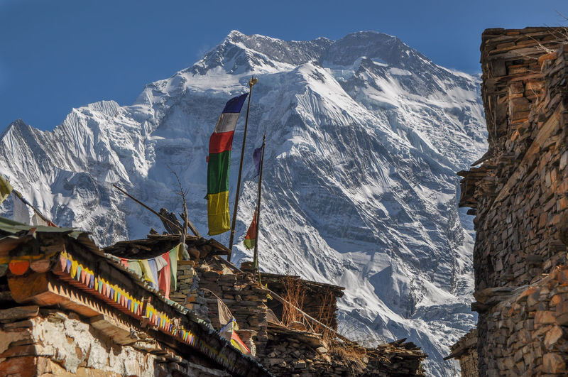 Nepal Annapurna Village Travel Trekking Buddhism Tibet Snow Mountain Snow Flag Winter Sky Architecture Building Exterior Built Structure A New Beginning
