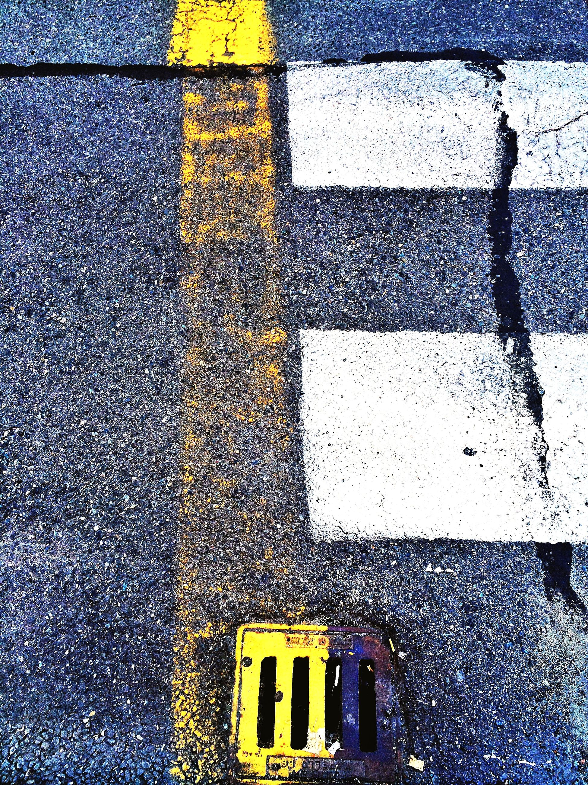 full frame, street, backgrounds, wet, transportation, yellow, road, rain, road marking, water, high angle view, season, textured, asphalt, window, day, architecture, weather, built structure, pattern