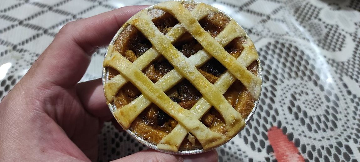 Close-up of hand holding dessert