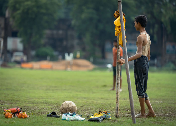 Full length of man playing on field