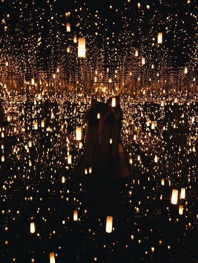 But do you know what infinity looks like? Awe WOW Abstract Art Exhibition 30s Silhouette Lights In The Dark Infinitymirroredroom Kusama Infinity Mirror Kusama Yayoi Illuminated Lighting Equipment Night Architecture Glowing No People Celebration Event Light Arts Culture And Entertainment