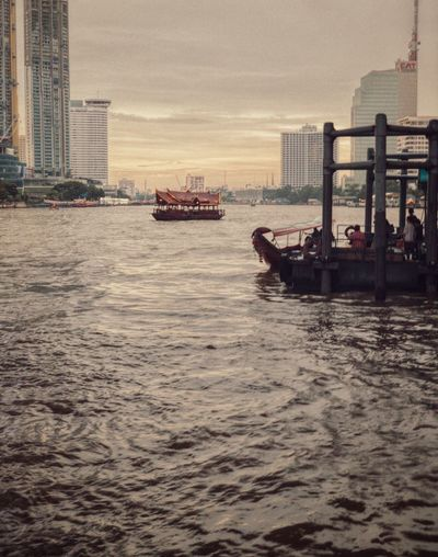 Scenic Thailand Bangkok Boat Tourist Destination Travel Travel Destinations River Scene River Nautical Vessel Transportation Water Mode Of Transportation Ship Sea Sky Built Structure Sunset Waterfront Passenger Craft