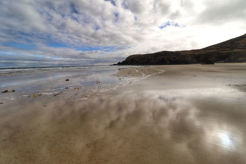 Traigh mor beach on Isle of Lewis Bucketlist Reflection Beachphotography Scotland Beach Beach Cloud - Sky Sky Nature Sand Tranquility Beauty In Nature Sea Water Scenics Tranquil Scene Landscape No People Outdoors Horizon Over Water Day Travel Destinations Low Tide