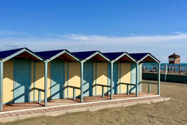 Wooden Huts On Sunny Beach In Italy