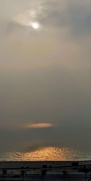 Sunrise with high humidity, Kuwait Sunset Orange Color Sky Horizon Over Water Dramatic Sky Calm Sky Only Atmospheric Mood Romantic Sky Coast Atmosphere Salt Basin