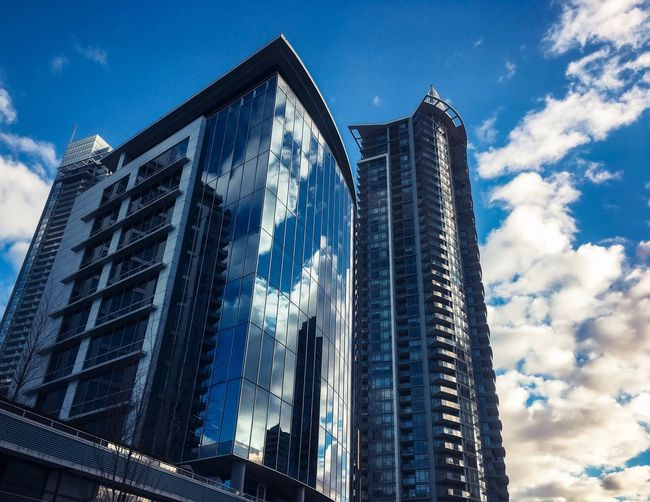 City life reflected Built Structure Architecture Low Angle View Sky Building Exterior Building Office Building Exterior City Tall - High Cloud - Sky No People Nature Blue Modern Day Office Tower Glass - Material Outdoors