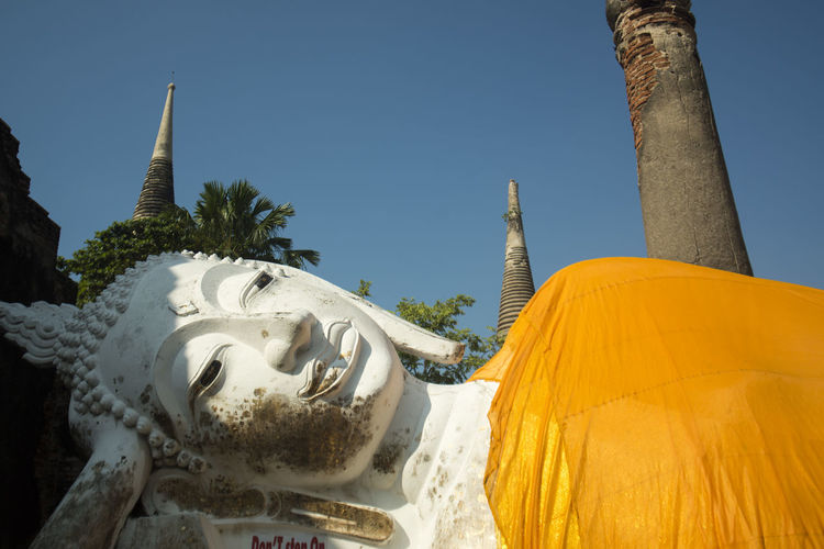 Close-up of reclining buddha statue in wat yai chai mongkhon temple