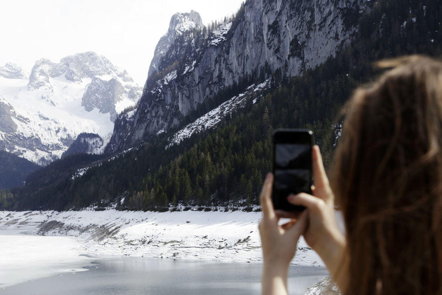 Activity Beauty In Nature Cold Temperature Communication Leisure Activity Mobile Phone Mountain Mountain Range One Person Outdoors Photographing Photography Themes Real People Smart Phone Snow Snowcapped Mountain Technology Telephone Using Phone Winter Wireless Technology