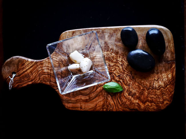 Basil Garlic Art And Craft Black Background Brown Close-up Craft Creativity Directly Above Food Food And Drink Freshness High Angle View Indoors  No People Representation Still Life Studio Shot Table Wood - Material