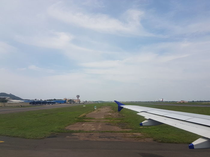 Air Vehicle Aircraft Wing Airplane Airplane Wing Airport Airport Runway Day Flying Grass Nature No People Outdoors Runway Sky Transportation Travel