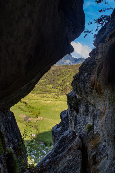 Beauty In Nature Cave Exit Landscape Mountain Nature No People Rock - Object Rock Formation Sky Tranquil Scene Water