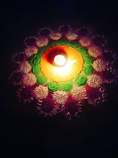 High angle view of illuminated lamp on black background