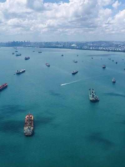 Off singapore's coast with ships, boats, tankers,  vessels the sea. high angle aerial view.