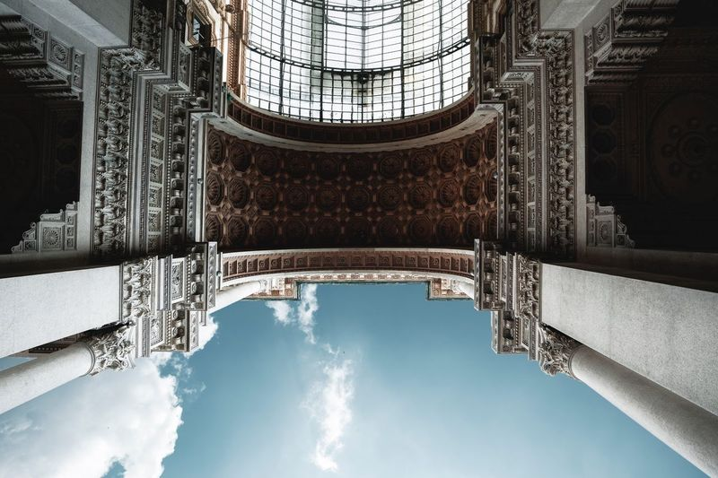 Milano Galleria Vittorio Emanuele Built Structure Architecture Sky Building Exterior Low Angle View Travel Destinations Nature Tower Cloud - Sky Travel City Reflection Outdoors Tourism Day Architectural Column Building History No People Water