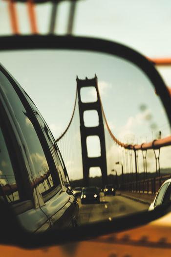 Close-up of bridge against sky in city
