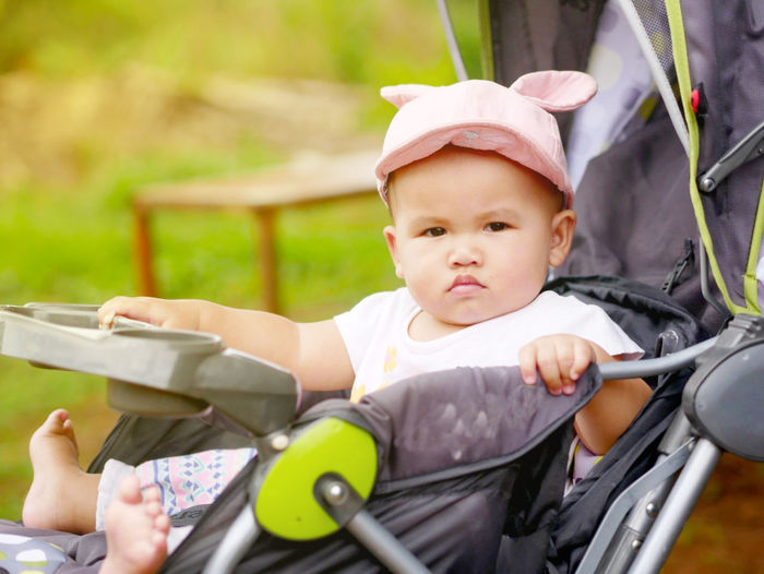 Childhood Real People One Person Toddler  Focus On Foreground Innocence Baby Stroller Cute Baby Carriage Day Portrait Front View Baby Clothing Outdoors Baby Young Child Babyhood