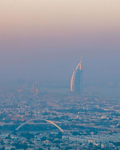 Distant view of burj al arab hotel during sunrise