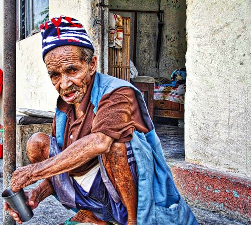 An Old Man With a Steel Glass Alone Care EyeEm Foster Care Help Human Representation Lonelyness Old Man Real People Sitting Wrinkles Hello World Check This Out Growth The Week Of Eyeem Alone Old Oldman