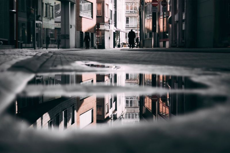 Built Structure Building Exterior Reflection Architecture City Water Puddle Outdoors Real People Day Rainy Season Nature Water Reflections Water Rain Rainy Mechelenbelgium Mechelen Canon Streetphotography City Street 50mm 50mm1.4 Sky