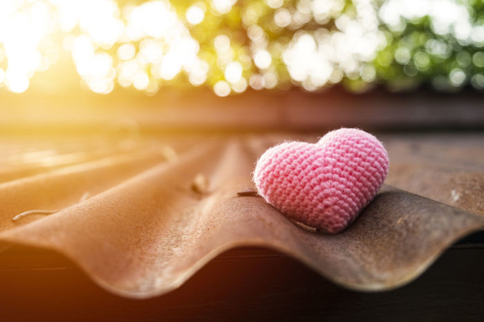 Pink heart knitting on roof in the morning sun. Backlit Heart Knitting Morning Light Morning Sun Pink Pink Heart Retro Valentine Valentine's Day  Ball Close-up Cute Dawn Day In Morning Love ♥ Lovely No People Old Roof On Roof Outdoor Pretty Vintage
