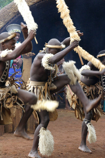 Zulu village - Land of a Thousand Hills -nr Durban, South Africa Dancing Real People Men Performance Day Standing Outdoors Dancer Skill  Zulu Nation Durban South Africa Arts Culture And Entertainment Human Body Part Land Of A Thousand Hills Zulu Dancers Zulu Warriors Zulu Village