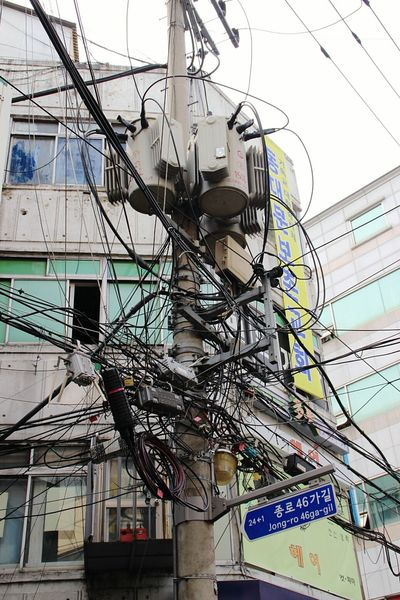Wired Electricity  Seoul South Korea Korea Urban Photography Street Photography Electricity Wires Strom Elektrizität Stromkasten Stromkabel Kabelsalat Kabel Cable Building Exterior Power Line  Low Angle View No People Technology Day Architecture Built Structure Connection Outdoors Power Cable Telephone Pole Fuel And Power Generation Electric Pole Wire Electrical Component