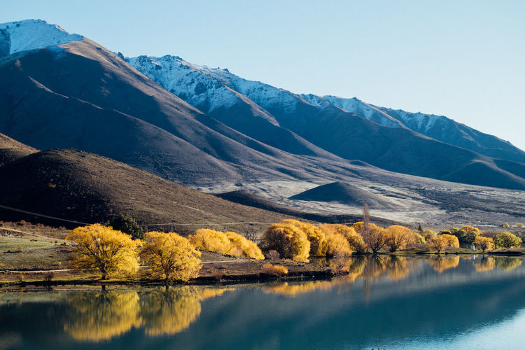 Lake Benmore near in Wanaka, New Zealand Beauty In Nature Calm Clear Sky Day Geology Lake Majestic Mountain Mountain Range Multi Colored Nature No People Non-urban Scene Outdoors Physical Geography Reflection Remote Scenics Standing Water Tourism Tranquil Scene Tranquility Vacations Water Waterfront