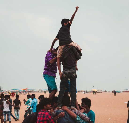 Standing tall .. Real People Group Of People Sky Lifestyles Men Leisure Activity Large Group Of People Crowd Clear Sky Women Adult Nature Land Day Beach Togetherness Enjoyment Water Incidental People Outdoors Human Arm Arms Raised Chennai Social Issues Protest Jallikattu History Victory Triumph Anger Energy Human Representation Event Tamilnadu Tamil The Photojournalist - 2019 EyeEm Awards The Street Photographer - 2019 EyeEm Awards