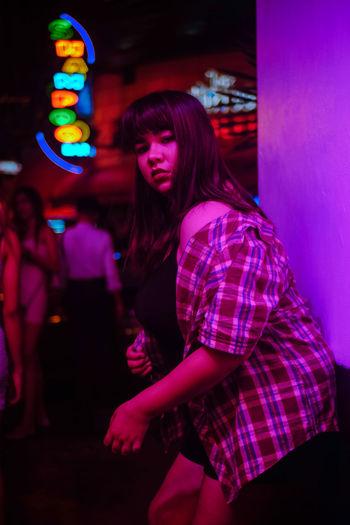 Young woman dancing at night