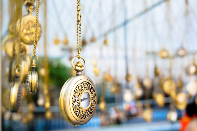 Close-up of pocket watches for sale