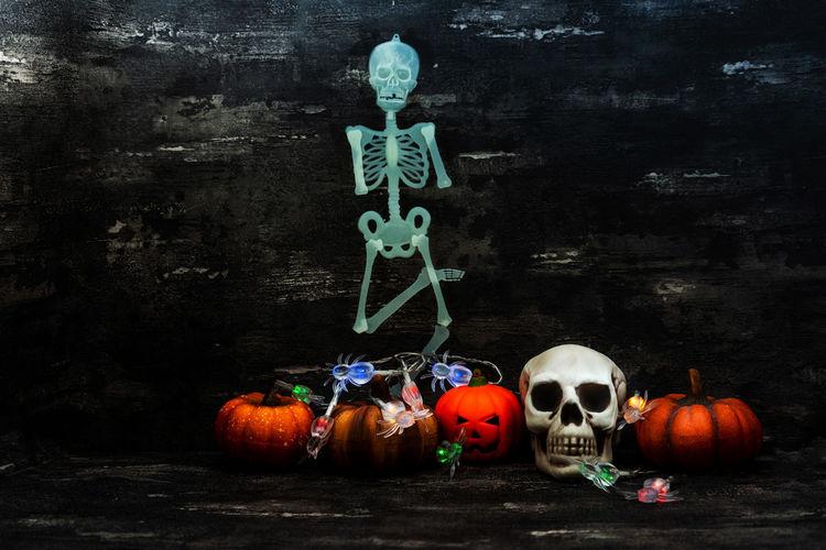 Pumpkin Halloween Celebration Food And Drink Food Spooky Holiday - Event Human Skeleton Creativity Art And Craft Jack O' Lantern Human Representation No People Craft Skeleton Fear Representation Still Life Horror Skull